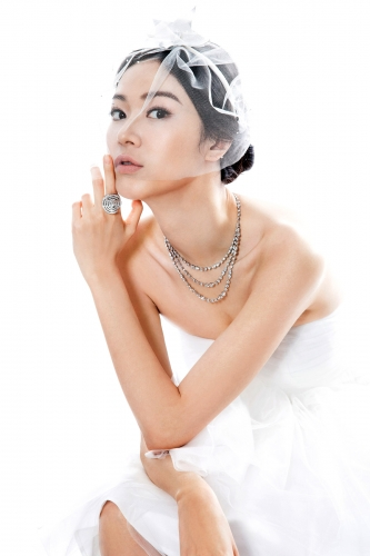 CARTIER High Jewellery Collection necklace and ring in platinum with diamonds (Individual price)   ATHENA VALOROUS white tulle dress (made-to-order) STEPHEN JONES veiled silver star headpiece $3,320 (from HATWOMAN)
