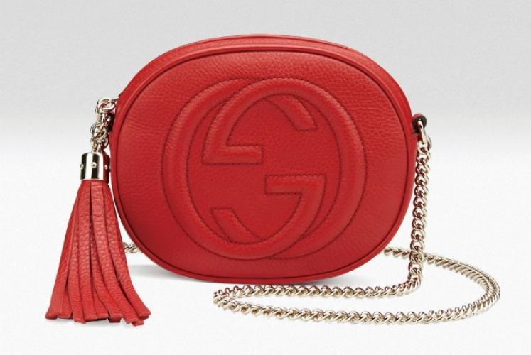 Gucci Soho 橙紅色消耗流蘇吊飾橢圓手袋  $7,900