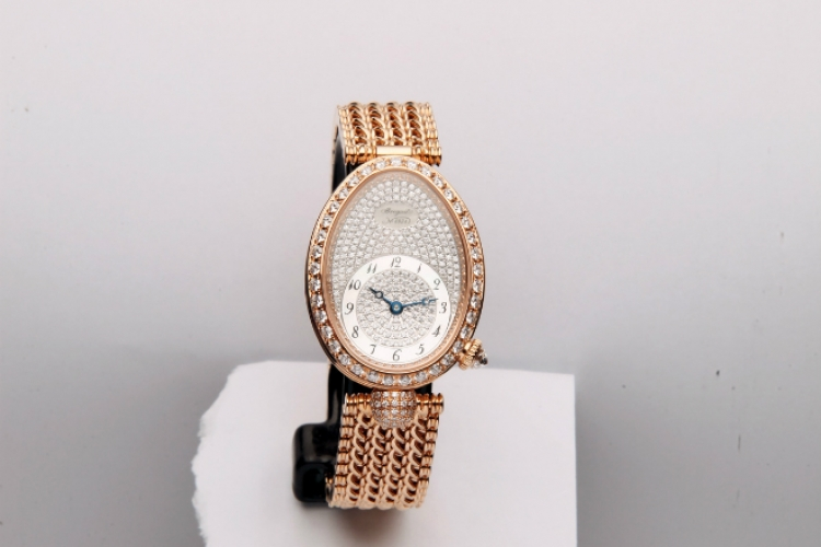 BREGUET watch in yellow gold and diamonds