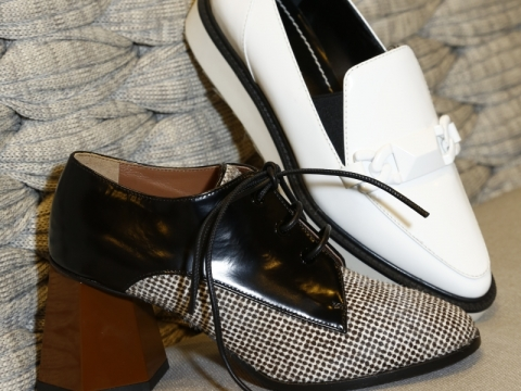 Left: Sportmax brogue shoes $2,520 (Original Price: $6,280) Right: Max Mara white flats $1,640 (Original Price: $4,080)