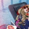 LISA MARIE FERNANDEZ Poppy bandeau bikini set $3,440 from NET-A-PORTER,EUGENIA KIM wide-brim striped woven straw sunhat $3,530